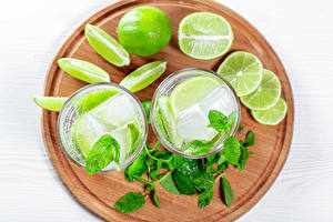 Pictures Drink Lime Mojito Cutting board Highball glass 2 Ice Leaf Mentha Food