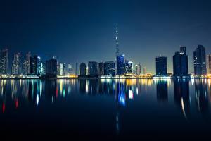 Bakgrunnsbilder Dubai Skyskrapere De forente arabiske emirater Natt Byer