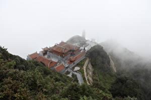 Bilder Gebirge Tempel Vietnam Nebel Von oben mount Fansipan, Lao Cai province, Buddhist temple Natur