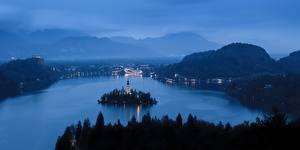 Bilder Sonnenaufgänge und Sonnenuntergänge See Insel Berg Slowenien Abend Nebel Bled