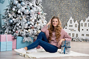 Pictures New year Blonde girl Smile Jeans Present New Year tree Balls Beautiful Girls