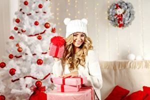 Photo Christmas New Year tree Gifts Box Balls Blonde girl Winter hat female
