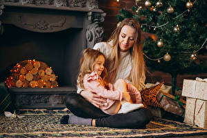 Pictures New year Mother Little girls Sitting Balls Fireplace Fairy lights Present child