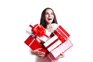 Fotos & Bilder Neujahr Weißer hintergrund Braunhaarige Freude Geschenke Schachtel Mädchens