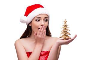 Fotos Neujahr Weißer hintergrund Mütze Erstaunen Hand Weihnachtsbaum Mädchens