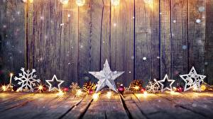 Hintergrundbilder Neujahr Bretter Schneeflocken Kugeln Stern-Dekoration