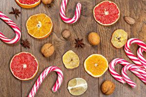 Fotos Zitrusfrüchte Süßigkeiten Dauerlutscher Sternanis Bretter Stück Lebensmittel
