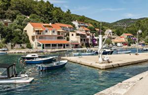 Bilder Kroatien Gebäude Bootssteg Motorboot Boot Bucht  Städte