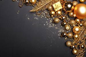 Bilder Schmuck Spielzeuge Neujahr Kugeln Gold Farbe