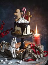 Bureaubladachtergronden Nieuwjaar Taart Koekjes Kaarsen Chocolade Paarden Spek snoep Voedsel