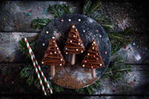 Hintergrundbilder Neujahr Schokolade Süßware Bretter Tannenbaum
