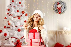 Image New year New Year tree Balls Box Present Blonde girl Smile Sweater Winter hat young woman