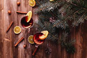 Sfondi desktop Capodanno Cannella Limoni Noci Bevande Tavole Di ramo Cibo