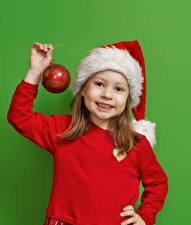 Images New year Colored background Little girls Winter hat Hands Balls Staring child