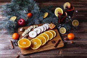 Pictures New year Drinks Orange fruit Cinnamon Apples Mandarine Wood planks Cutting board Branches Mug Food