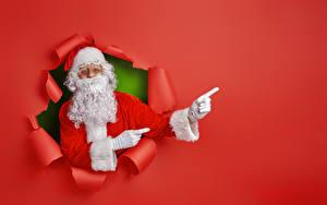 Bilder Neujahr Finger Farbigen hintergrund Weihnachtsmann Bärtiger Mütze Vorlage Grußkarte