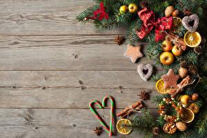Fotos Neujahr Dauerlutscher Äpfel Kekse Zimt Sternanis Bretter Ast Schleife Vorlage Grußkarte das Essen