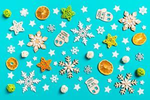 Desktop hintergrundbilder Neujahr Fausthandschuhe Schneeflocken Kleine Sterne