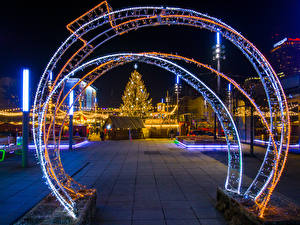 Wallpapers New year Poland Building Evening New Year tree Fairy lights Street Katowice