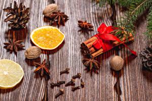 Sfondi desktop Capodanno Anice stellato Cannella Frutta arancione Noce Tavole Pigne Cibo