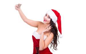 Bilder Neujahr Weißer hintergrund Brünette Mütze Lächeln Hand Selfie junge Frauen