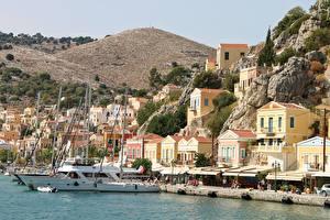 Fotos Schiffsanleger Jacht Griechenland Gebäude Felsen Simi Island Städte