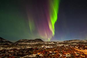 Desktop hintergrundbilder Norwegen Polarlicht Nacht Hügel Natur
