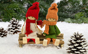 Images Toys Two Sitting Winter hat Scarf Pine cone Doll