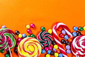 Fotos Bonbon Süßware Dauerlutscher Dragee Farbigen hintergrund Vorlage Grußkarte Lebensmittel