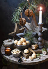 Pictures New year Candles Pastry Nuts Still-life Balls Food