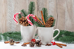 Fotos Neujahr Zimt Dauerlutscher Sternanis Zwei Tasse Ast Zapfen