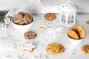 Hintergrundbilder Neujahr Kekse Kerzen Schneeflocken Kleine Sterne das Essen