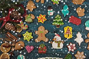 Fotos Neujahr Kekse Zimt Design Zapfen Weihnachtsbaum Schneemänner Herz das Essen
