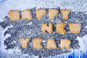 Photo New year Cookies Powdered sugar English Lettering