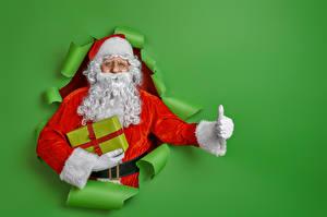 Hintergrundbilder Neujahr Finger Farbigen hintergrund Weihnachtsmann Barthaar Geschenke