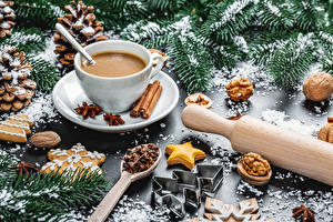 Photo New year Hot chocolate drink Cinnamon Nuts Cookies Star anise Illicium Branches Cup Conifer cone