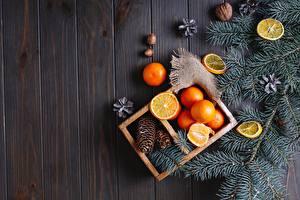 Hintergrundbilder Neujahr Mandarine Schalenobst Zitronen Bretter Ast Zapfen das Essen