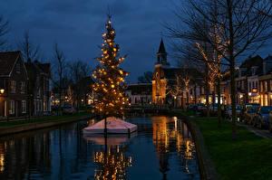 Bilder Neujahr Niederlande Gebäude Abend Kanal Tannenbaum Lichterkette Weesp