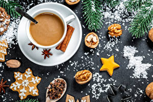 Pictures New year Nuts Cookies Cinnamon Cocoa Star anise Illicium Branches Cup Little stars