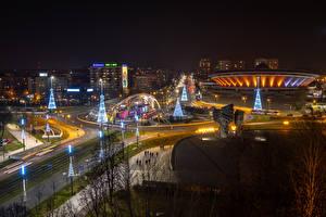 Wallpaper New year Poland Building Roads New Year tree Street lights Fairy lights Night time Street Katowice Cities