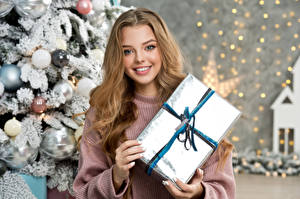 Pictures New year Smile Staring Present Hands Sweet Dark Blonde female