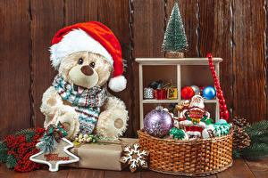 Bakgrundsbilder på skrivbordet Jul Nallebjörn Julgran Vinterhatt Korgar Bollar Snowflake