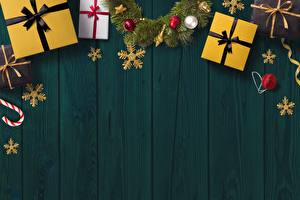 Hintergrundbilder Neujahr Bretter Vorlage Grußkarte Geschenke Schneeflocken