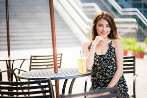 Photo Mixed drink Asiatic Sitting Table Dress Smile Brown haired Pretty female
