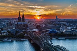 Wallpaper Cologne Germany River Bridges Cathedral Riverboat Sunrises and sunsets Rhine Cities