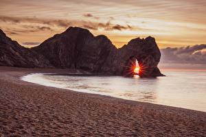 Bilder England Sonnenaufgänge und Sonnenuntergänge Küste Felsen Sand Lulworth Camp Purbeck District Natur