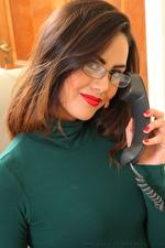 Images Maria Smith Brown haired Phone Hands Smile Staring Eyeglasses young woman