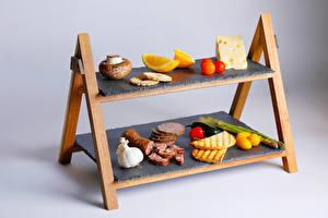 Fotos Pilze Käse Wurst Tomaten Zitrone Knoblauch Brot Grauer Hintergrund