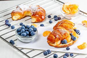 Pictures Baking Buns Blueberries Powdered sugar Orange fruit