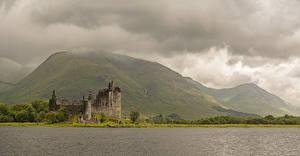 Fotos Schottland Burg Ruinen See Gebirge Laubmoose Kilchurn Castle Loch Awe Städte Natur